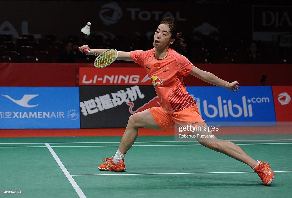 Wang Shixian of China competes against Carolina Marin of Spain in the quarter finals match of the 2015 Total BWF World Championship at Istora Senayan...