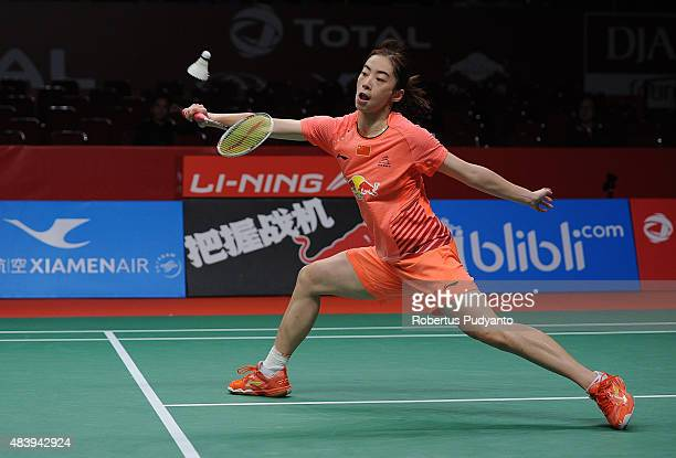 Wang Shixian of China competes against Carolina Marin of Spain in the quarter finals match of the 2015 Total BWF World Championship at Istora Senayan...
