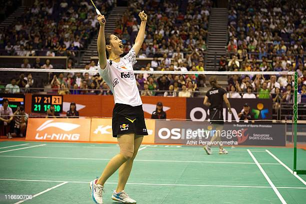 Wang Shixian of China competes in her match against Juliane Schenk of Germany during day four of the LiNing Singapore Open at Singapore Indoor...