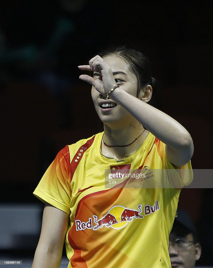 Wang Shixian of China gestures during a match against Ratchanok Intanon of Thailand in the women's singles event of the 2012 BWF Superseries Finals in Shenzhen, south China's Guangdong province on December 15, 2012. Wang beat Ratchanok 21-12, 21-19 to move into the final. AFP PHOTO