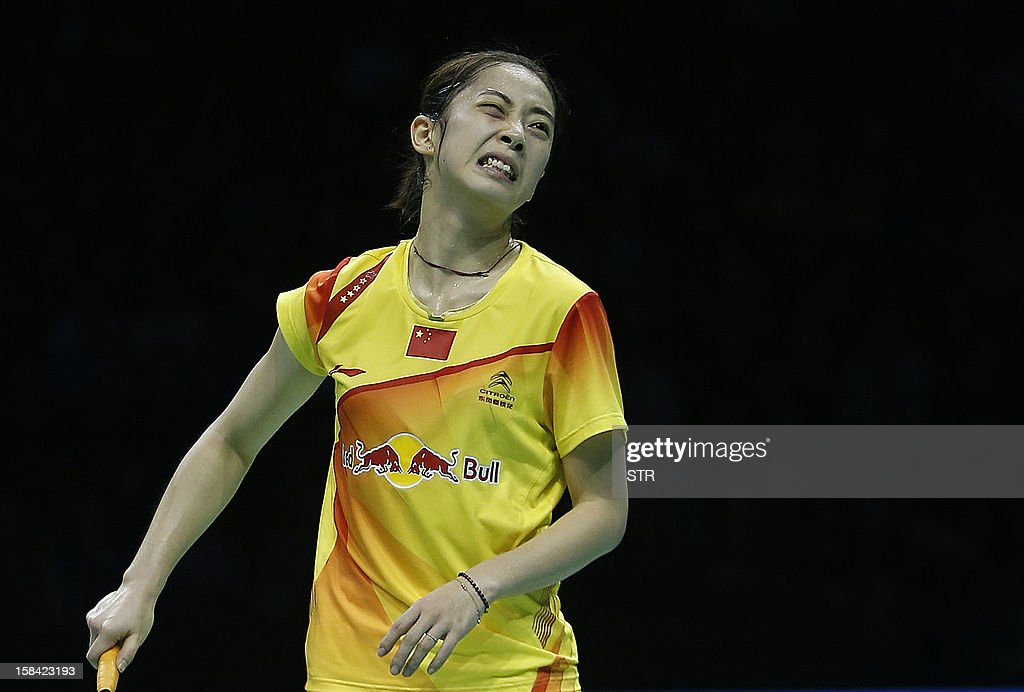 Wang Shixian of China grimaces in pain during the final match against compatriot Li Xuerui in the women's singles of the 2012 BWF Superseries Finals in Shenzhen, south China's Guangdong province on December 16, 2012. Li beat Wang 21-9, 15-4 (retired) for the title. AFP PHOTO