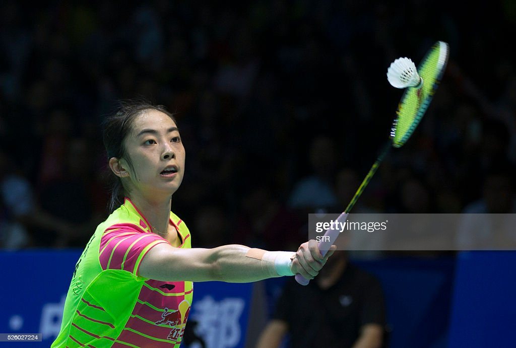 Wang Shixian of China hits a return against Saina Nehwal of India during their women's singles quarter-final match at the 2016 Badminton Asia Championships in Wuhan, central China's Hubei province on April 29, 2016. / AFP / STR