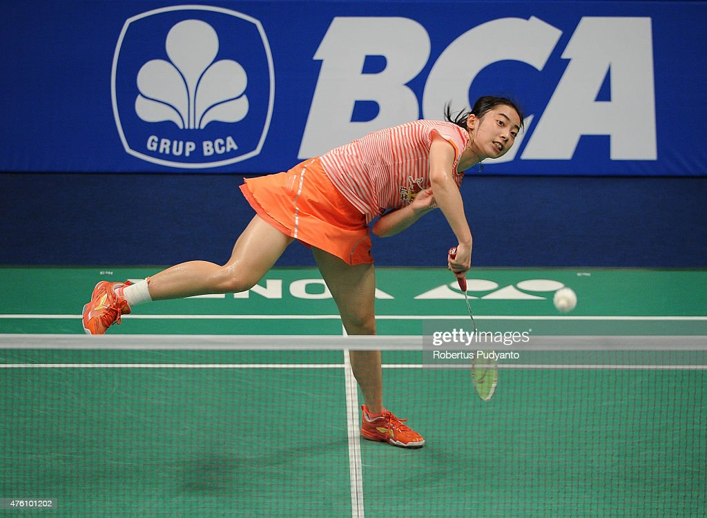 Wang Shixian of China play a shot against Ratchanok Intanon of Thailand during the 2015 BCA Indonesia Open Semifinals match at Istora Senayan on June 6, 2015 in Jakarta, Indonesia.