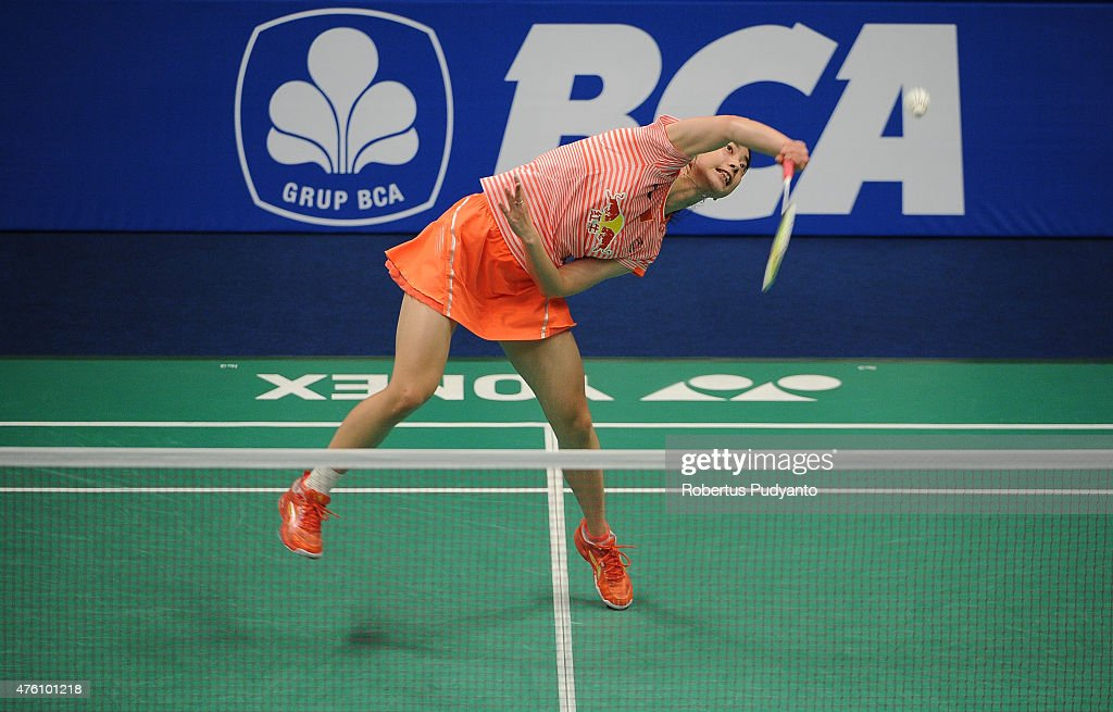 Wang Shixian of China play a shot against Ratchanok Intanon of Thailand during the 2015 BCA Indonesia Open Semifinals match at Istora Senayan on June...