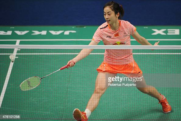 Wang Shixian of China play a shot against Ratchanok Intanon of Thailand during the 2015 BCA Indonesia Open Semifinals match at Istora Senayan on June...