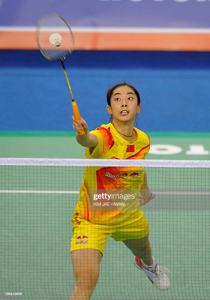 Wang Shixian of China plays a shot during her women's singles badminton match against Minatsu Mitani of Japan during the semi-finals of the Korea Open at Seoul on January 12, 2013. Wang Shixian won the match 21-11, 21-17.