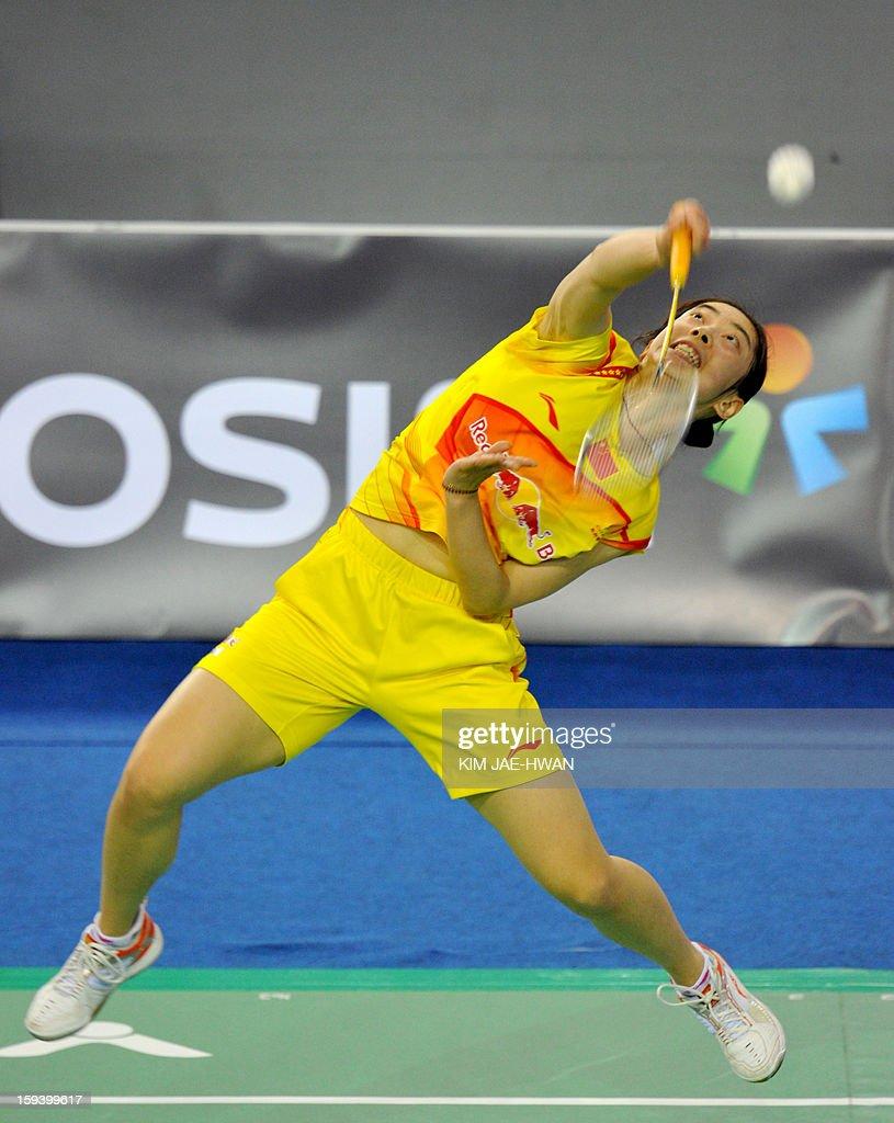 Wang Shixian of China plays a shot during their women's singles badminton match against Sung Ji-Hyun of South Korea during the finals of the Korea Open at Seoul on January 13, 2013. Sung Ji-Hyun won the match 21-12, 22-20.