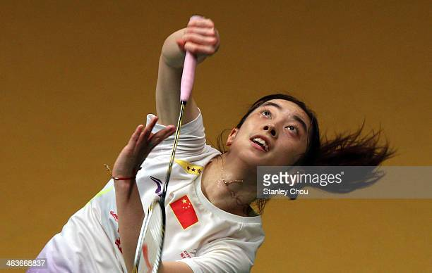 Wang Shixian of China plays a shot to Li Xuerui of China during the Final of the Malaysia Badminton Open on January 19 2014 in Kuala Lumpur Malaysia
