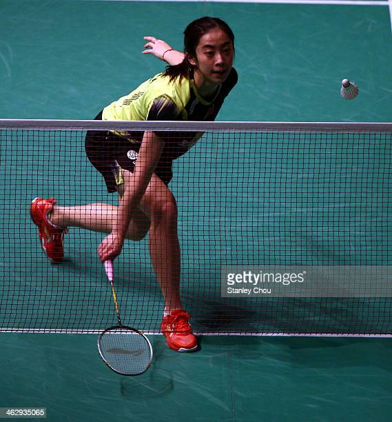 Wang Shixian of China plays a shot to Sun Yu of China during day three of the Women's Singles of the Malaysia Badminton Open on January 16 2014 in...