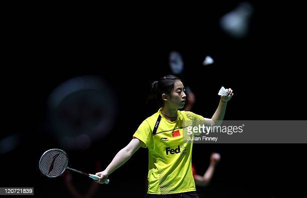 Wang Shixian of China prepares to serve to Linda Zechiri of Bulgaria during day two of the BWF World Badminton Championships and LOCOG Test Event for...
