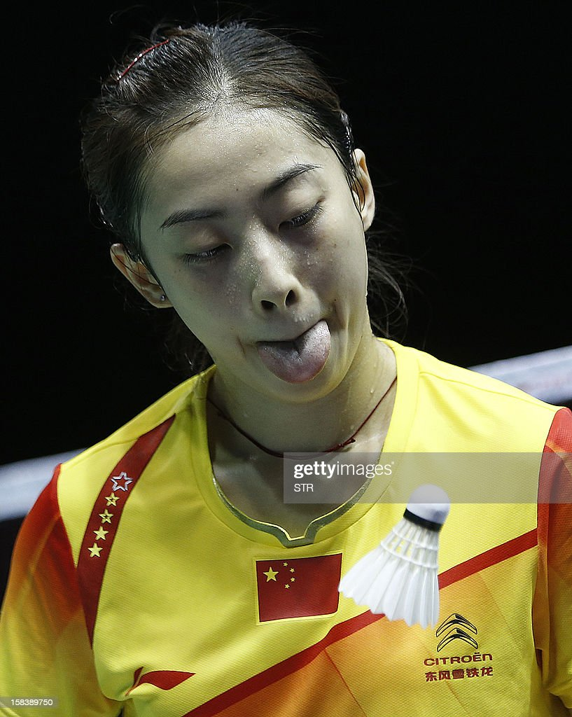 Wang Shixian of China reacts during a match against Ratchanok Intanon of Thailand in the women's singles event of the 2012 BWF Superseries Finals in Shenzhen, south China's Guangdong province on December 15, 2012. Wang beat Ratchanok 21-12, 21-19 to move into the final.