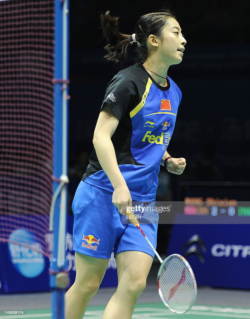 Wang Shixian of China reacts to a winning point against Lindaweni Fanetri of Indonesia during the Group A match at the Uber Cup world badminton team championships in China's central city of Wuhan, in Hubei province on May 22, 2012. Wang Shixian won the match.
