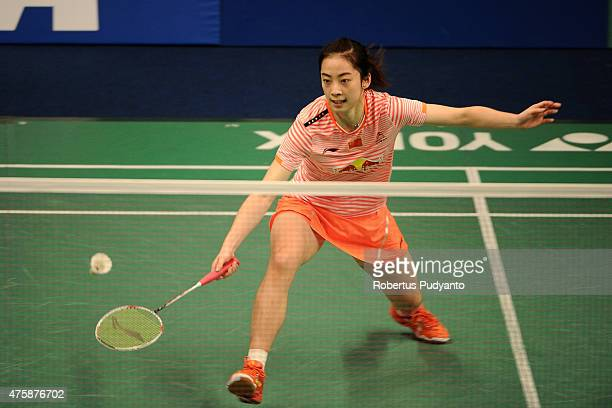 Wang Shixian of China returns a shot against Bae Yeon Ju of Korea during the 2015 BCA Indonesia Open Round 2 match on June 4 2015 in Jakarta Indonesia