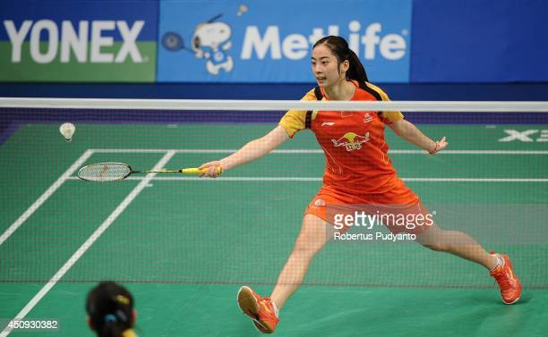 Wang Shixian of China returns a shot against Busanan Ongbumrungpan of Thailand during the BCA Indonesia Open 2014 MetLife BWF World Super Series...