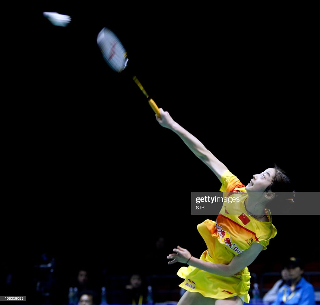Wang Shixian of China returns a shot against Eriko Hirose of Japan in the women's singles event of the 2012 BWF Superseries Finals in Shenzhen, in southern China's Guangdong province on December 14, 2012. Wang beat Hirose 21-15, 8-21, 21-15 to move into the next round.