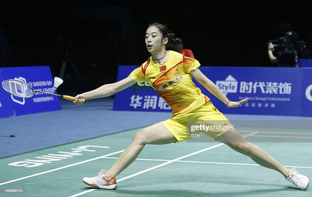 Wang Shixian of China returns a shot against Ratchanok Intanon of Thailand in the women's singles event of the 2012 BWF Superseries Finals in Shenzhen, south China's Guangdong province on December 15, 2012. Wang beat Ratchanok 21-12, 21-19 to move into the final.