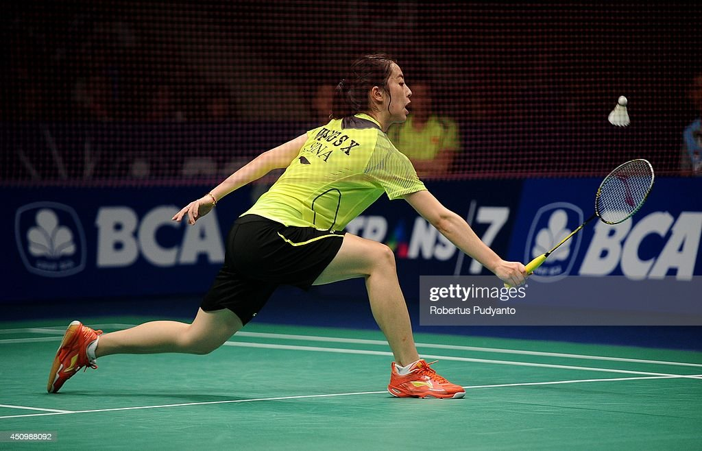 Wang Shixian of China returns a shot against Ratchanok Intanon of Thailand during the semifinal BCA Indonesia Open 2014 MetLife BWF World Super...