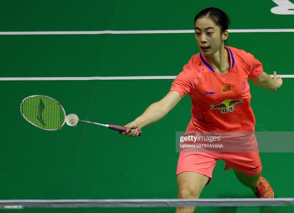 Wang Shixian of China returns a shot against Spain's Carolina Marin during their women's singles semifinal match at the 2015 Malaysia Open Badminton...