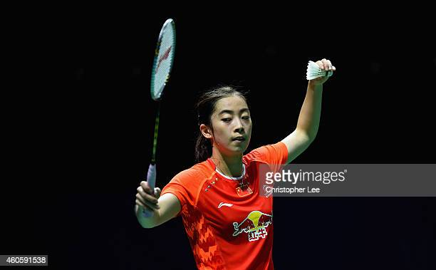 Wang Shixian of China serves as she plays against Saina Nehwal of India in the Womens Singles during day one of the BWF Destination Dubai World...