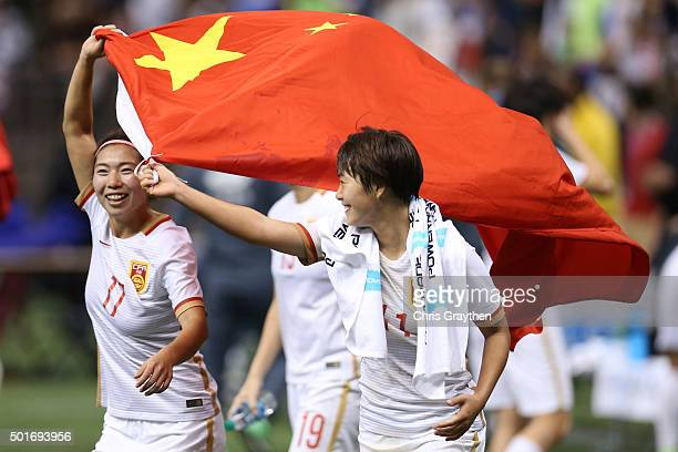 Wang Shuang and Gu Yasha of China celebrate after defeating the United States 10 at the MercedesBenz Superdome on December 16 2015 in New Orleans...