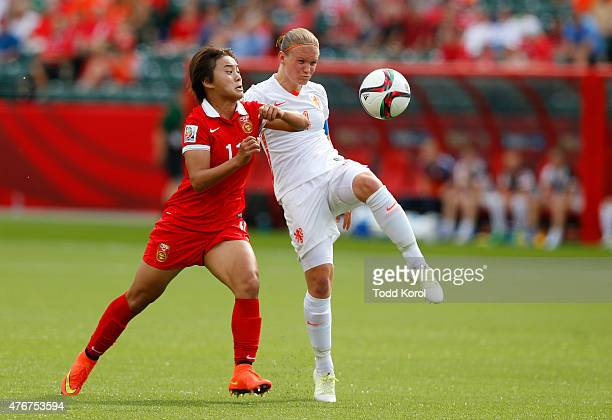 Wang Shuang of China and Mandy Van Den Berg of Netherlands battle for the ball during the FIFA Women's World Cup Canada Group A match between China...