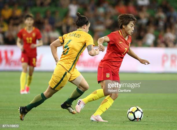 Wang Shuang of China PR is chased by Chloe Logarzo of the Matildas during the Women's International match between the Australian Matildas and China...