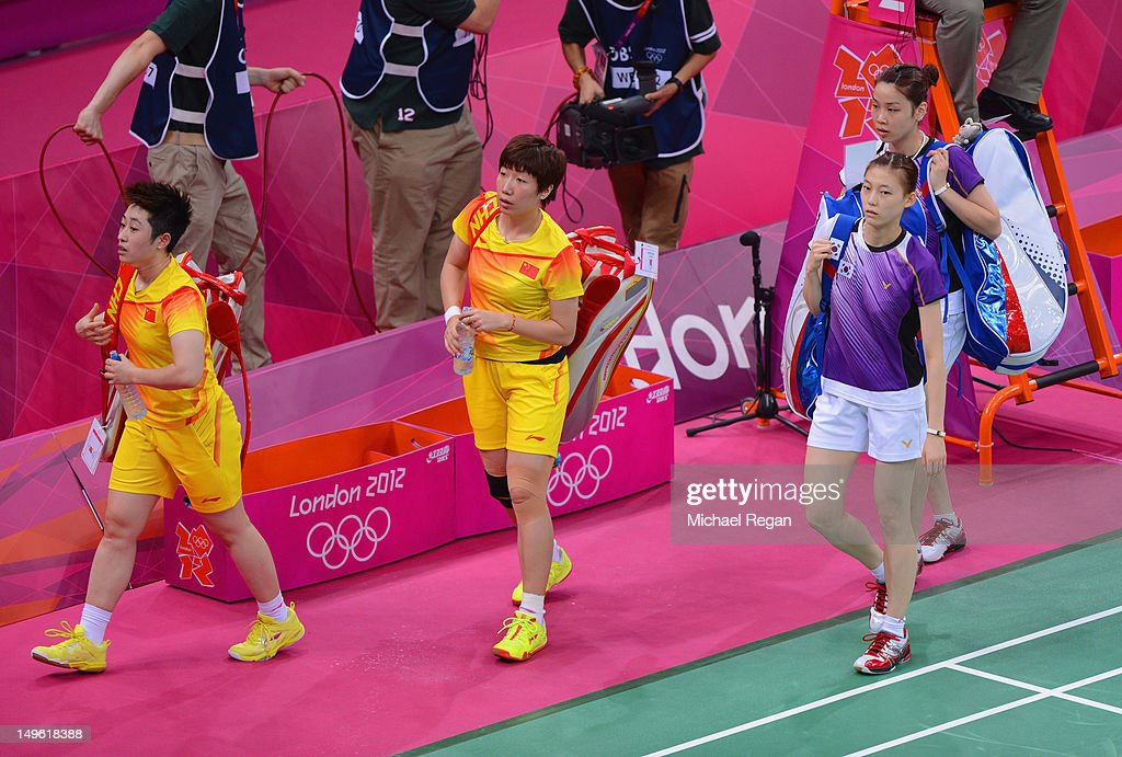 Wang Xiaoli and Yang Yu of China leave the court with Ha Na Kim and Kyung Eun Jung of Korea after their Women's Doubles Badminton on Day 4 of the London 2012 Olympic Games at Wembley Arena on July 31, 2012 in London, England.