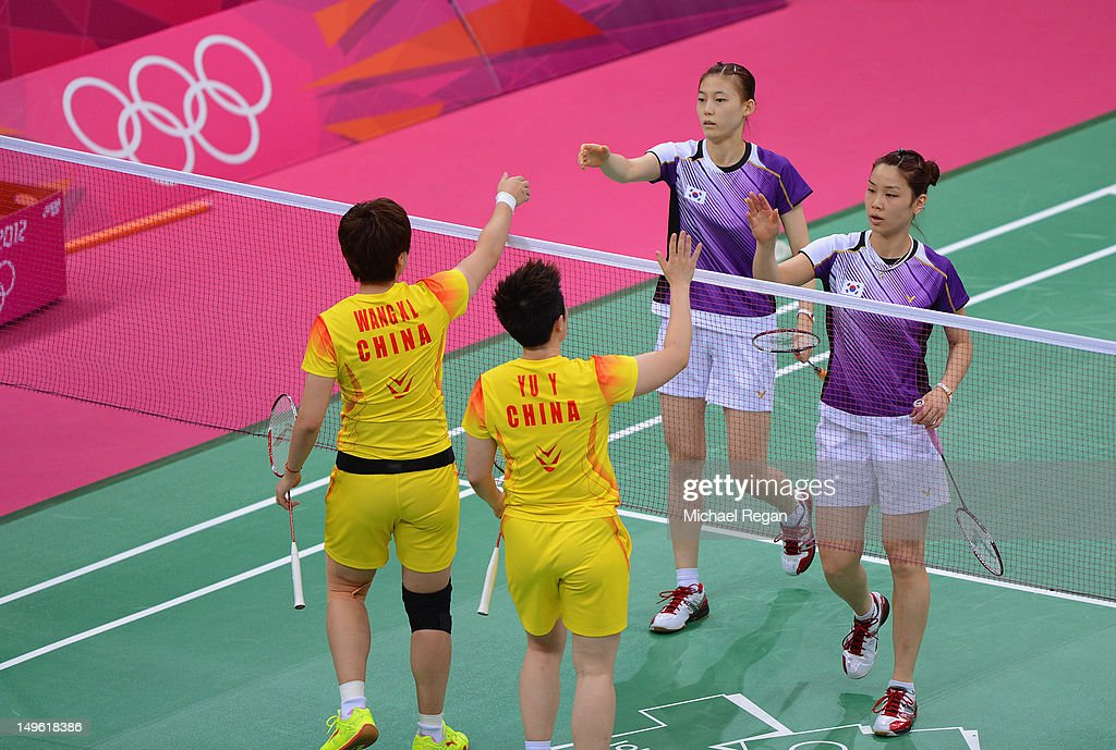 Wang Xiaoli (L) and Yang Yu (R) of China shake hands with Ha Na Kim and Kyung Eun Jung of Korea after their Women's Doubles Badminton on Day 4 of the London 2012 Olympic Games at Wembley Arena on July 31, 2012 in London, England.