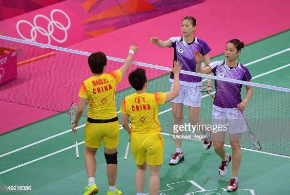 Wang Xiaoli and Yang Yu of China shake hands with Ha Na Kim and Kyung Eun Jung of Korea after their Women's Doubles Badminton on Day 4 of the London...