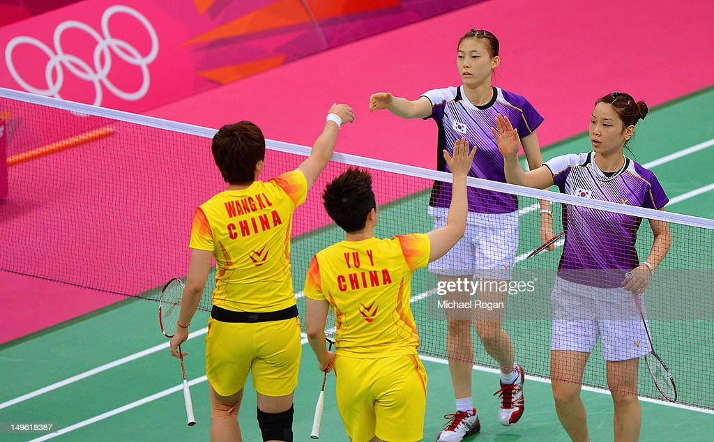 Wang Xiaoli (L) and Yang Yu (R) of China shake hands with Ha Na Kim and Kyung Eun Jung of Korea after their Women's Doubles Badminton during Badminton match on Day 4 of the London 2012 Olympic Games at Wembley Arena on July 31, 2012 in London, England.
