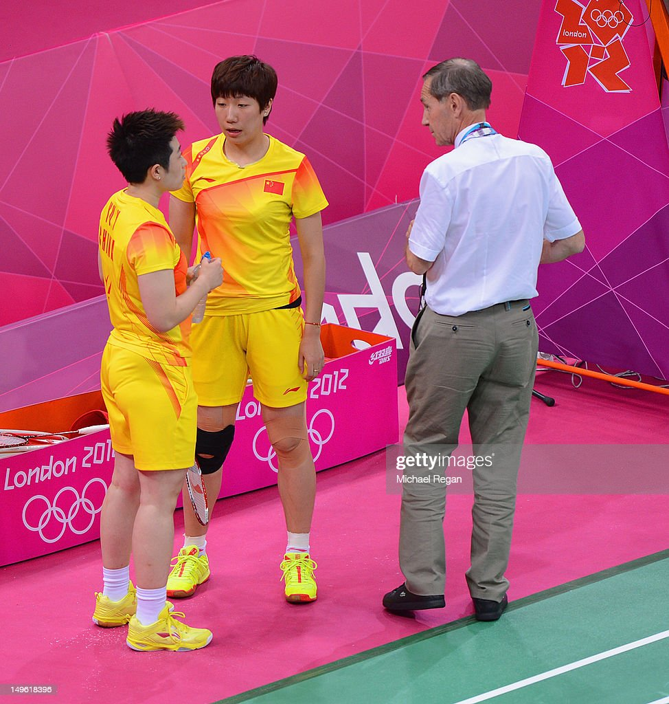 Wang Xiaoli and Yang Yu of China speak to an official during their match against Ha Na Kim and Kyung Eun Jung of Korea in their Women's Doubles Badminton on Day 4 of the London 2012 Olympic Games at Wembley Arena on July 31, 2012 in London, England.