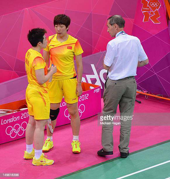 Wang Xiaoli and Yang Yu of China speak to an official during their match against Ha Na Kim and Kyung Eun Jung of Korea in their Women's Doubles...