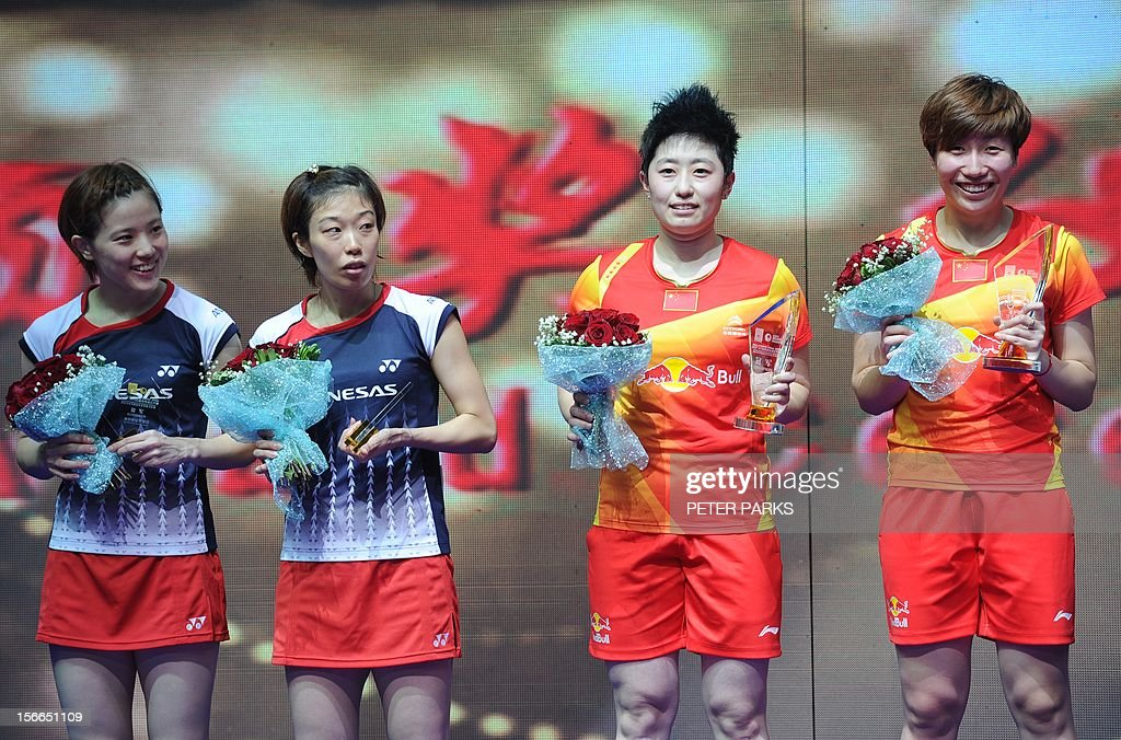 Wang Xiaoli (R) and Yu Yang (2nd R) celebrate on the podium after beating Miyuki Maeda (2nd L) and Satoki Suetsuna (L) of Japan in the women's doubles final at the China Open badminton tournament in Shanghai on November 18, 2012. AFP PHOTO/Peter PARKS