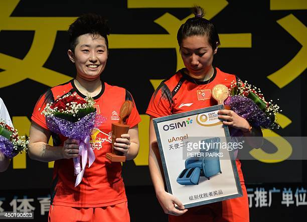 Wang Xiaoli and Yu Yang of China celebrate on the podium after beating compatriots Bao Yixin and Zhong Qianxin in the women's doubles final at the...