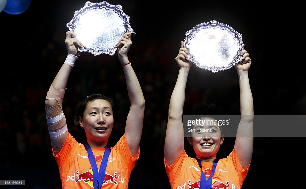 Wang Xiaoli and Yu Yang of China celebrate with their trophy's after defeating Cheng Shu and Zhao Yunlei of China in the final of the women's doubles during Day 6 of the Yonex All England Badminton Open at NIA Arena on March 10, 2013 in Birmingham, England.