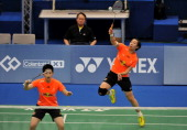 Wang Xiaoli and Yu Yang of China hits a return against Ma Jin and Tang Jinhua of China in their women's doubles final of the Badminton Asia...
