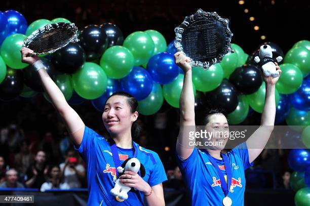 Wang Xiaoli and Yu Yang of China hold their awards after beating Ma Jin and Tang Yuanting of China in their All England Open Badminton Championships...