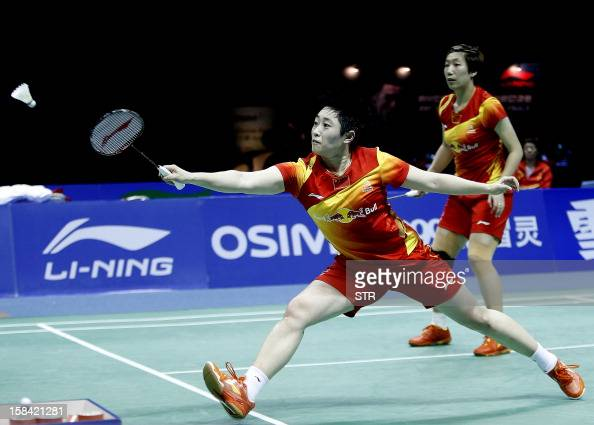 Wang Xiaoli and Yu Yang of China in action against Christinna Pedersen and Kamilla Rytter Juhl of Denmark in the women's doubles event of the 2012...