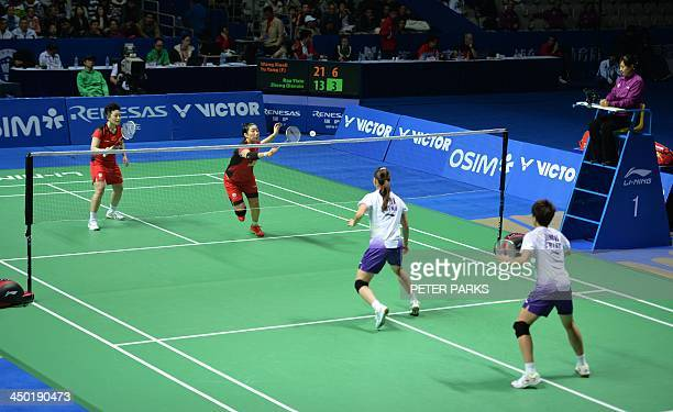 Wang Xiaoli and Yu Yang of China play compatriots Bao Yixin and Zhong Qianxin in the women's doubles final at the China Open badminton tournament in...
