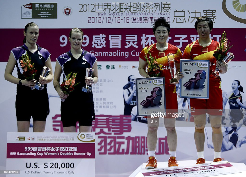 Wang Xiaoli and Yu Yang (R) of China pose with Christinna Pedersen and Kamilla Rytter Juhl (R) of Denmark during the award ceremony for the women's doubles event of the 2012 BWF Superseries Finals in Shenzhen, south China's Guangdong province on December 16, 2012. Wang and Yu beat Pedersen and Juhl 21-16, 21-14 for the title. AFP PHOTO