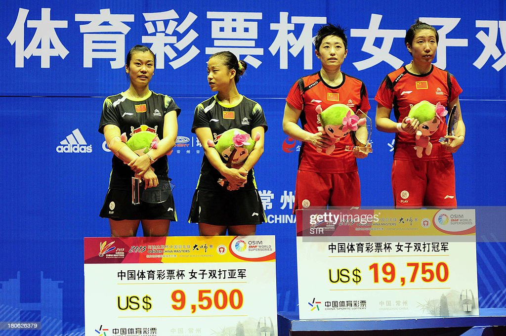 Wang Xiaoli (R) and Yu Yang (2R) of China pose with compatriots Ma Jin (2L) and Tang Jinhua (L) during the award ceremony after winning the women's doubles final match of the 2013 China Masters in Changzhou, east China's Jiangsu province on September 15, 2013. Wang and Yu won 21-17, 21-16. CHINA