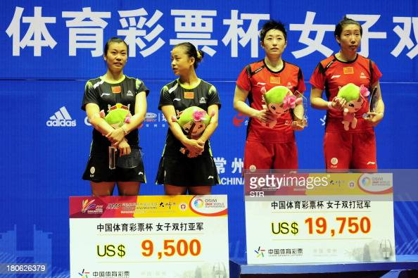 Wang Xiaoli and Yu Yang of China pose with compatriots Ma Jin and Tang Jinhua during the award ceremony after winning the women's doubles final match...
