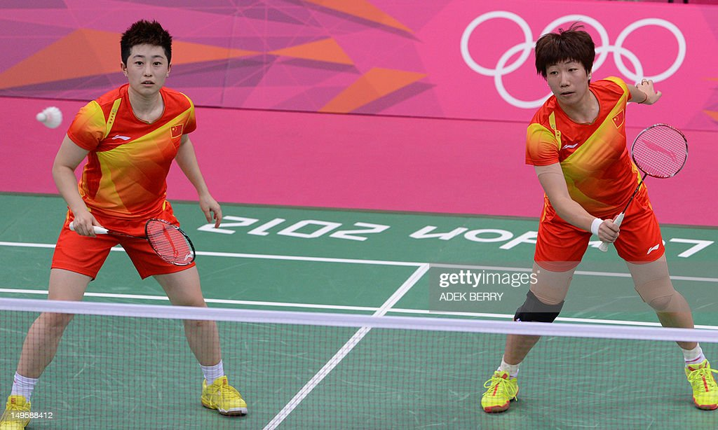 Wang Xiaoli (R) and Yu Yang (L) play a shot during their women's double badminton match against Kim Ha Na and Jung Kyung Eun of South Korea during the London 2012 Olympic Games in London on July 31, 2012. South Korean won the match 21-14, 21-11.