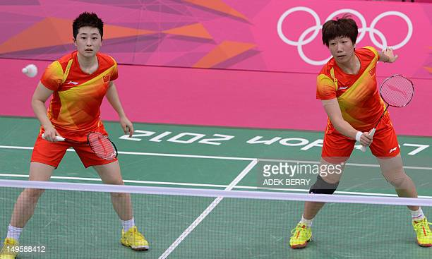 Wang Xiaoli and Yu Yang play a shot during their women's double badminton match against Kim Ha Na and Jung Kyung Eun of South Korea during the London...