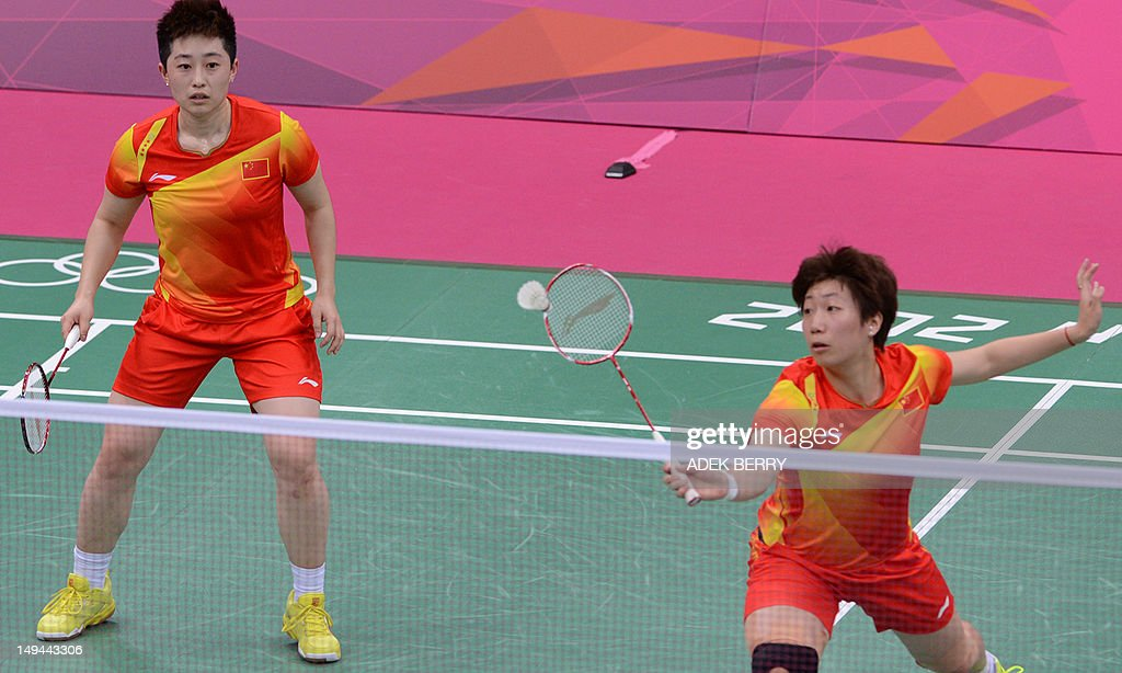 Wang Xiaoli of China (R) and Yu Yang watch the shuttlecock during their women's doubles badminton match against Alex Bruce and Michele Li of Canada at the London 2012 Olympic Games in London on July 28, 2012. China's Yu Yang and Wang Xioli won 21-11, 21-7.