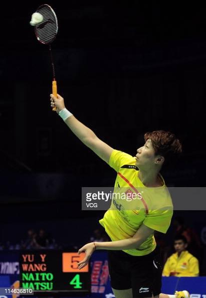 Wang Xiaoli of China in action against Mami Naito and Shizuka Matsuo of Japan during day three of the 12th Sudirman Cup at Qingdao Sports Center on...
