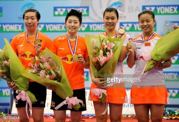 Wang Xiaoli Yu Yang Ma Jin and Tang Jinhua of China pose with their medals after their women's doubles final of the Badminton Asia Championships in...
