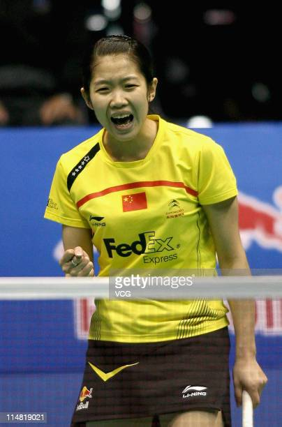 Wang Xin of China celebrates in her match against Saina Nehwal of India during day five of the 2011 Sudirman Cup at Qingdao Sports Center on May 26...