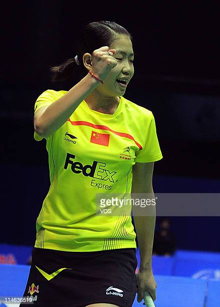 Wang Xin of China reacts during her match against Sayaka Sato of Japan during day three of the 12th Sudirman Cup at Qingdao Sports Center on May 24...