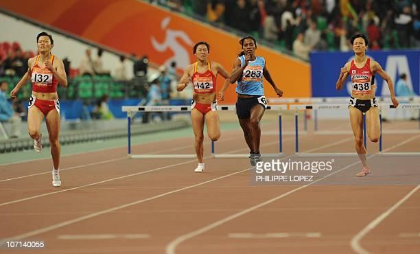 Wang Xing of China Yang Qi of China Jauna Murmu of India and Miyabi Tago of Japan compete in his women's 400m hurdles final in the athletics...